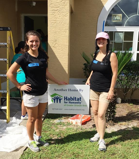 MHM Team Members volunteering for Habitat for Humanity, October 2014.