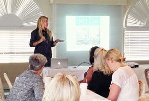 Megan Morris speaking at the Women's Council of Realtors Luncheon